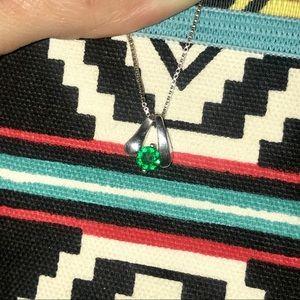 Single emerald stone set in 925 silver necklace
